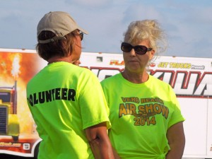 Sue Dempsey talks with another volunteer during a break in the Vero Beach Air Show.